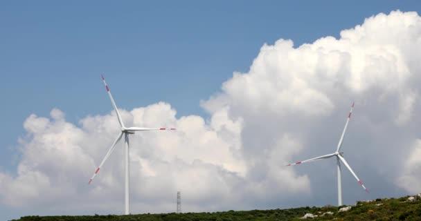 Wind turbines farm on green hill 5