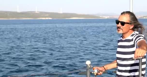 Man fishing on boat at summer vacation 9