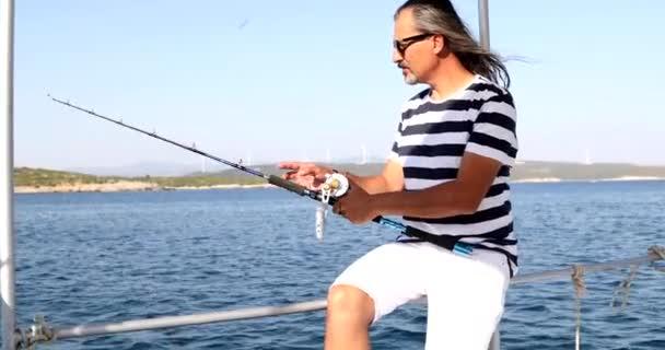 Man fishing on boat at summer vacation 2