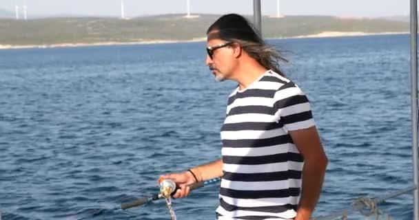 Man fishing on boat at summer vacation 6