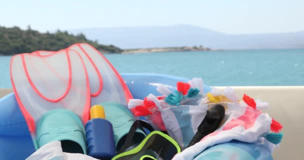 Summer vacation background with Flippers diving mask snorkel and sunscreen on yacht deck