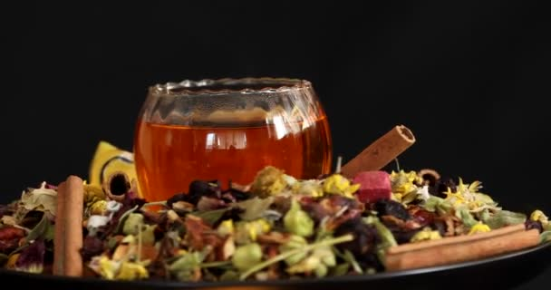 Cup of healthy tea with different kind of dryed herbs and flowers