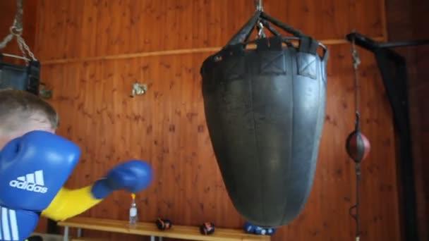 VINNITSA, UKRAINE, AUGUST 9, 2018: Team of boxers from Ukraine. Man in boxing stance training. The future of Ukrainian boxing. Training of boxers.