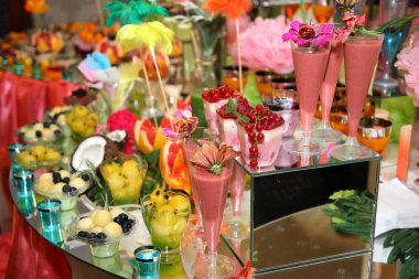 Sweet buffet of fruits and berries. Fruit receptions at the wedding. Delicious and tasty dessert table.