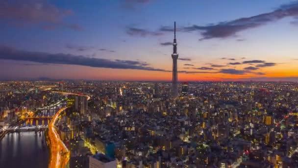 Luftaufnahme Hyper lapse 4k Video der Stadt Tokio bei Sonnenaufgang in Tokio, Japan. (Text und Logo verschwimmen lassen.