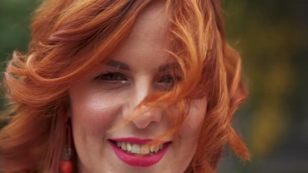 45f102713d6 Portrait of a beautiful woman with red hair. Close-up of a woman's face.  Slow motion.