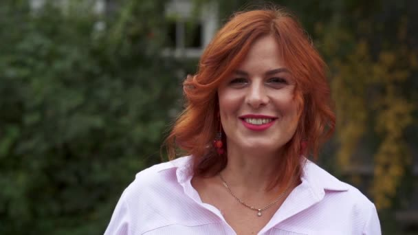 3004e512b8c Portrait of a beautiful woman with red hair. Slow motion.