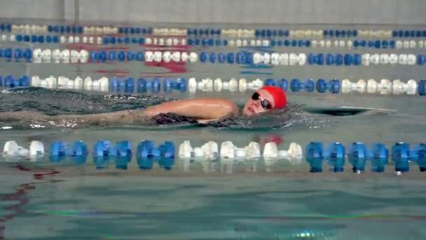 SLOW MOTION: Female athlete swimming slowly in crawl style. Woman enjoying swimming.
