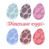 Set of colorful dinosaur eggs on white background