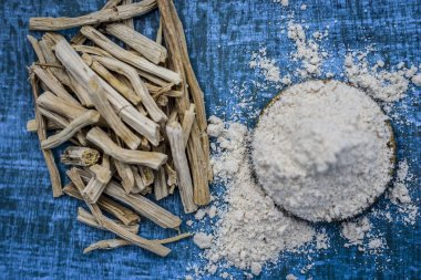 Close up view of ayurvedic herb satavari,Asparagus racemosus with its powder and roots