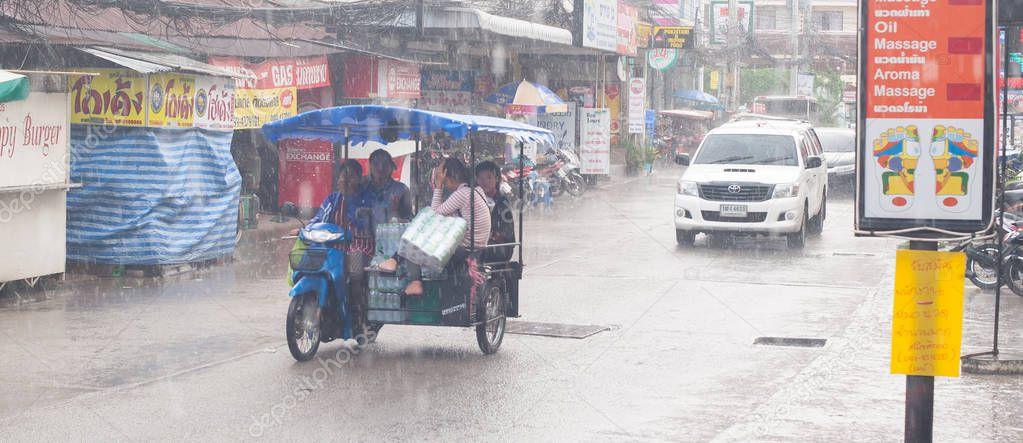PATTAYA THAILAND - CIRCA MAY 2018.  Wet Thai streets and traffic during heavy tropical storm rain. Monsoon season. Day editorial shot