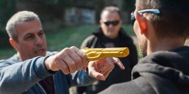 BELGRADE, SERBIA - 11. OCTOBER 2018. Kapap instructor Avi Nardia demonstrates self defense techniques against a gun point attack on KAPAP SELF DEFENSE SEMINAR