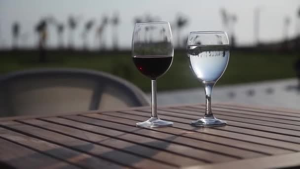 two glasses of wine and water on the table close-up