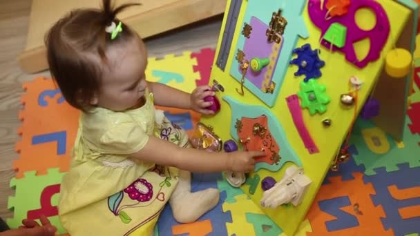 Toys for preschool and kindergarten child. little girl playing with educational toy