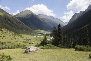 View of the yurt settlement of the valley of Altyn-Arashan in Kyrgyzstan