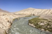 Pamir River in the Pamir Mountains on the border between Tajikistan (left side) and Afghanistan (right side)