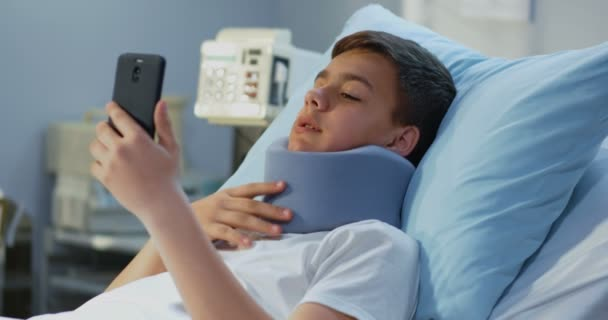 Teenager patient using cell phone in hospital