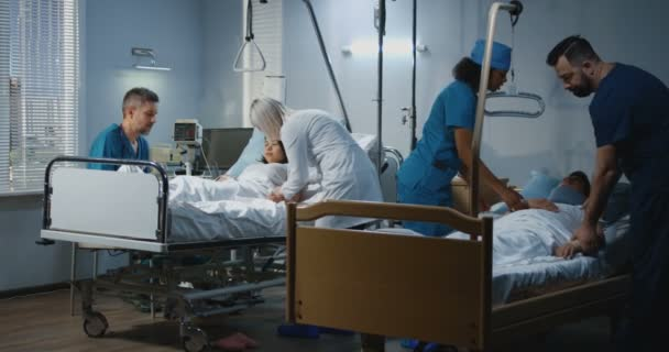 Doctors and nurses dealing with patients in hospital