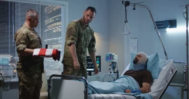 Injured soldier receives badge of honor in hospital