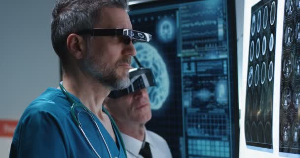 Doctors examining brain scan with VR headset