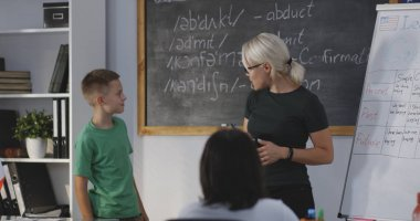 Teacher giving instruction to student