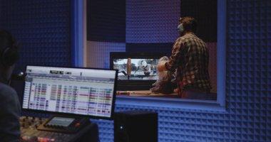 Medium shot of foley artist and sound engineer working in studio stock vector