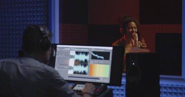 Actor doing voice over in sound studio