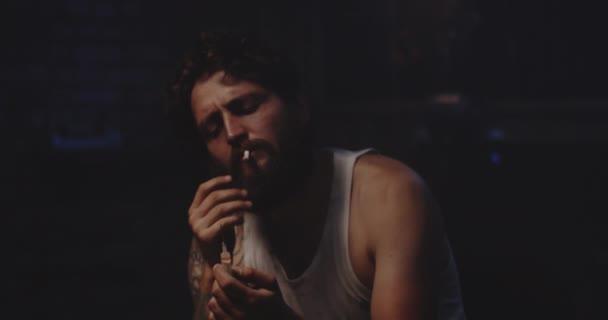 Man heating drug in a spoon