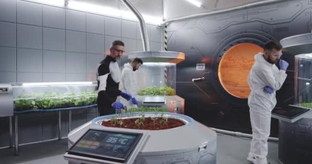 Scientist planting seedlings on Martian base