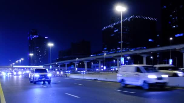 cars drive on Sheikh Zayed highway at night in Dubai