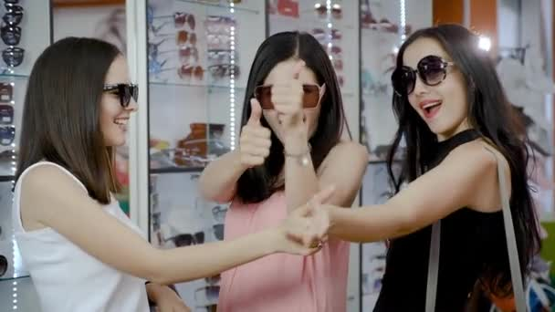 Women are happy with the choice of sunglasses.