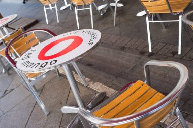 MOSCOW, RUSSIA - July 06, 2016. Round table and chairs of an open summer cafe