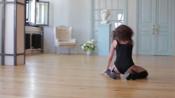 Attractive woman dancing in cozy studio