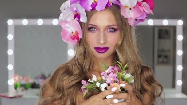 Woman with flowers and bright makeup