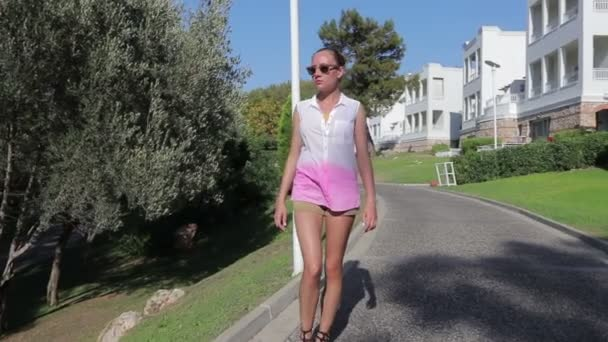 Beautiful girl walking around the hotel
