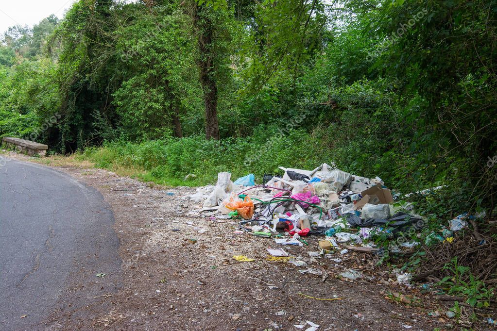 ROME, Italy - June 21, 2018: garbage abandoned in the countryside near the road