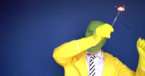 Senior takes off his mask overjoyed with a charming smile background blue with studio light clothing yellow