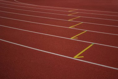 empty red running road track background texture sport concept and  white marking lanes with space for copy or text