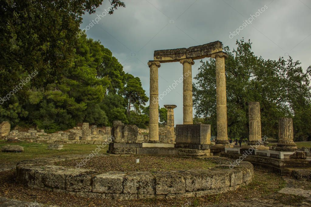 abandoned antique marble architecture building colonnade forum from ancient Greece times in park outdoor famous touristic heritage site for sightseeing and travel in Peloponnese peninsula