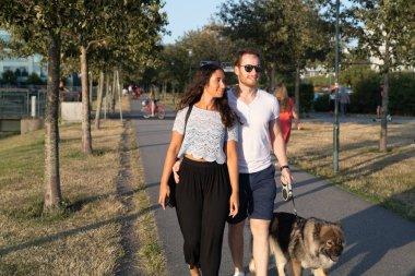 Couple walking in urban beach area