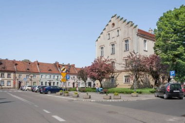 Pyskowice, Poland - May 05, 2018: The market rebuilt after a fire in 1822 according to the medieval plan of the city, the town hall from 1823 preserved unchanged until today and historic tenement houses.