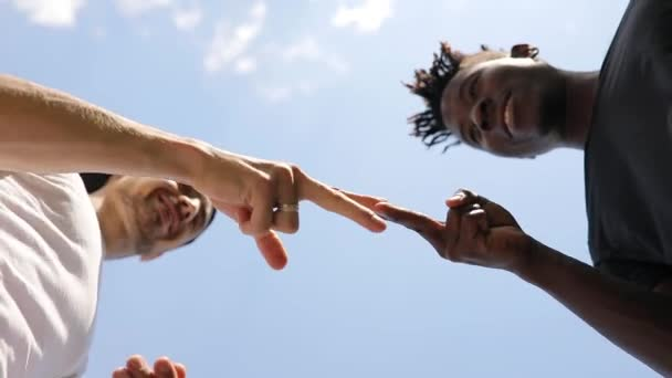 Friends play to Rock Paper Scissors game outdoor