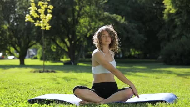 Young woman make yoga exercise in park, healthy lifestyle concept