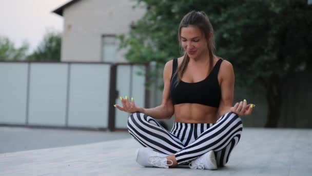 Adult woman meditating outdoor, yoga lotus pose