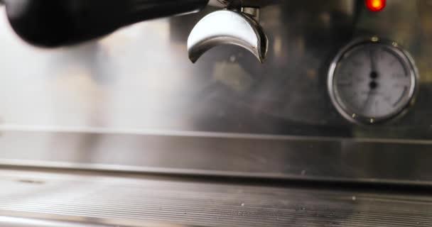 Machine pouring espresso into two cups