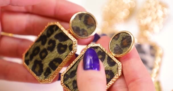 Jewelry in a female hands, woman holding expensive earrings, macro video