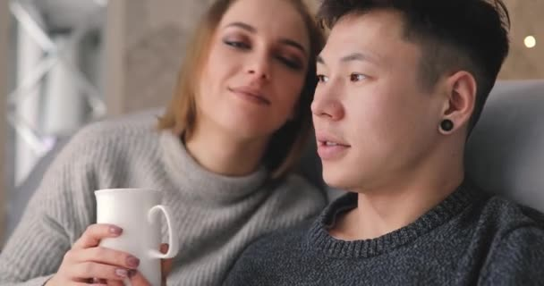 Love, relationship, couple together sitting on sofa at home