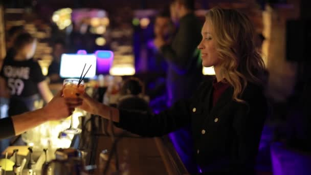 Girl take an alcohol cocktail on a bar