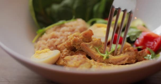 Macro video of take piece of curry chicken from plate