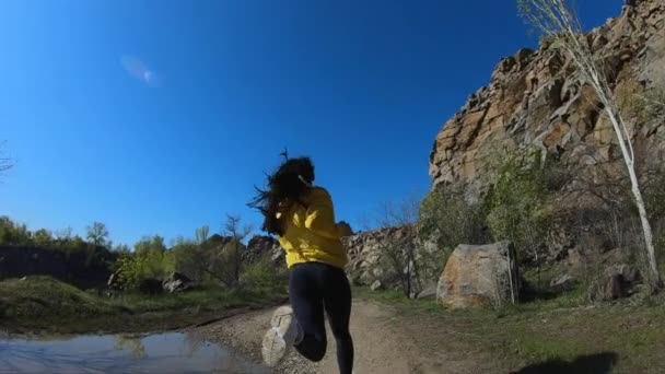 Fitness woman running on nature, mountain landscape, slow motion